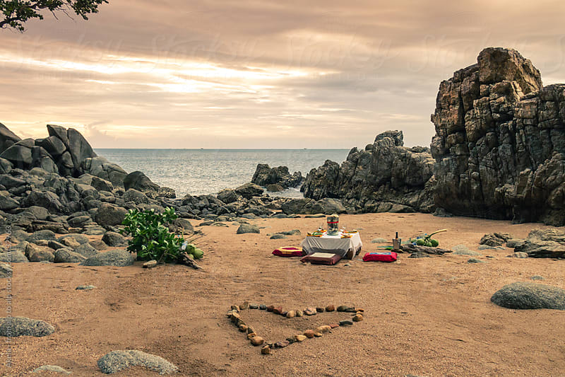 romantic dinner on the beach by Leander Nardin for Stocksy United