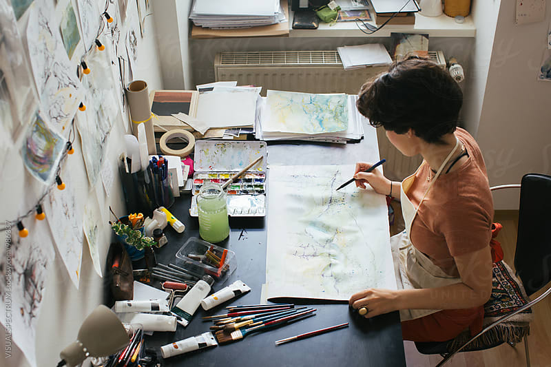 Overhead Shot of Young Female Painter Creating Original Artwork Using Watercolors and Art Pen by Julien L. Balmer for Stocksy United