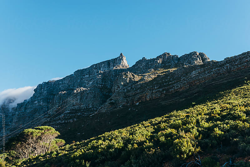 Beautiful landscape of sunny rocky Table Mountain by Trent Lanz for Stocksy United