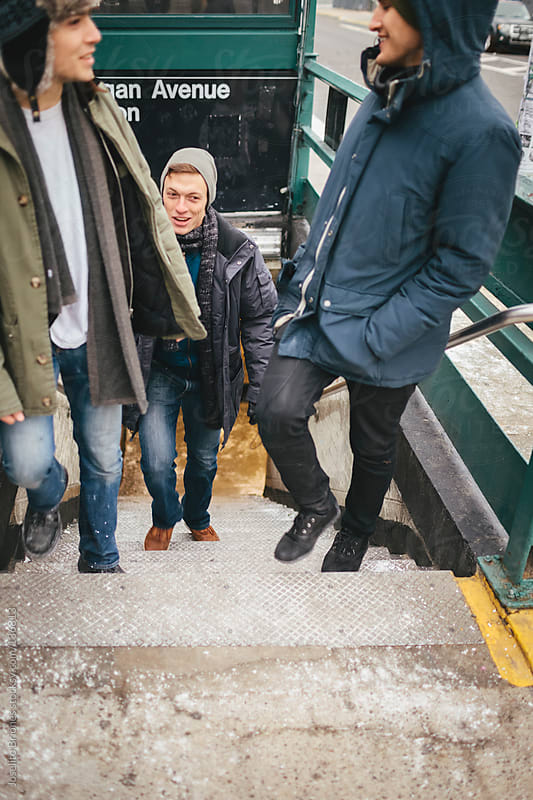 Group of Student Male Friends Coming Out of a Brooklyn Subway Station by Joselito Briones for Stocksy United