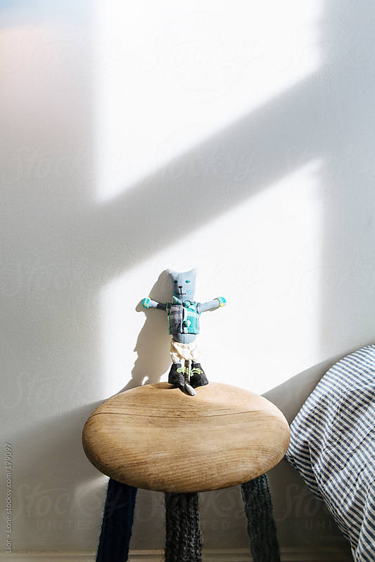 Small puppet on a stool by Lior + Lone for Stocksy United
