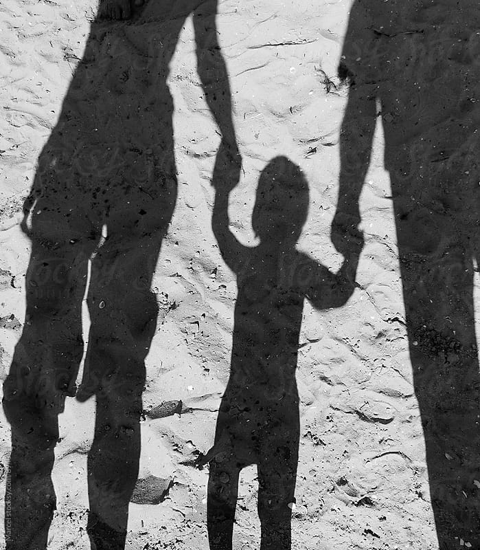 Family shadow on the beach by Marcel for Stocksy United