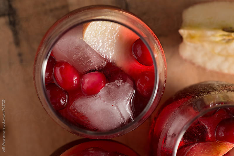 Apple Cranberry Cocktails From Above by Jeff Wasserman for Stocksy United