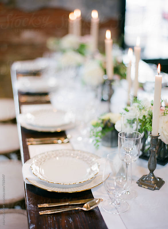 Formal reception table settings by Marta Locklear for Stocksy United