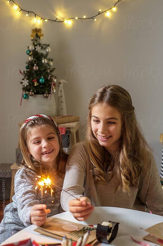 Two Little Girls Holding Sparklers by Aleksandra Jankovic for Stocksy United