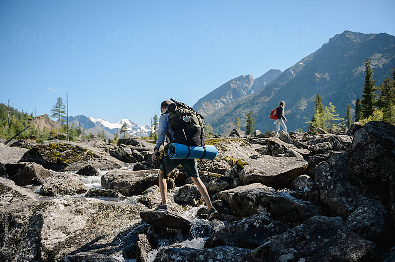 Group of hikers climbing on stones by Milles Studio for Stocksy United