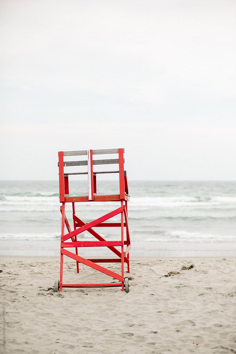 Red Lifeguard Chair A The Beach On An Overcast Day By Léa Jones For Stocksy  United