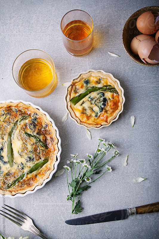 Asparagus,broccoli and blue cheese quiche. by Darren Muir for Stocksy United