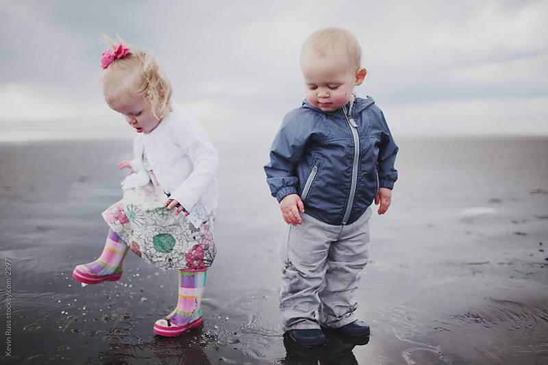 Beach Puddle Stomping Toddlers by Kevin Russ for Stocksy United