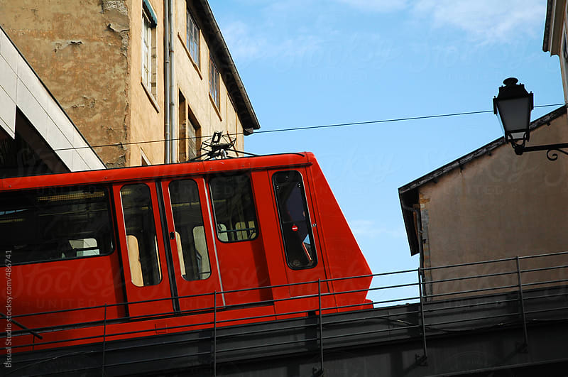 Red tram in Lyon by Bisual Studio for Stocksy United