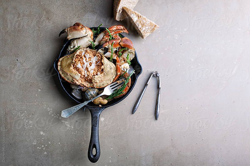 Dressed crab served with crusty bread.From above. by Darren Muir for Stocksy United