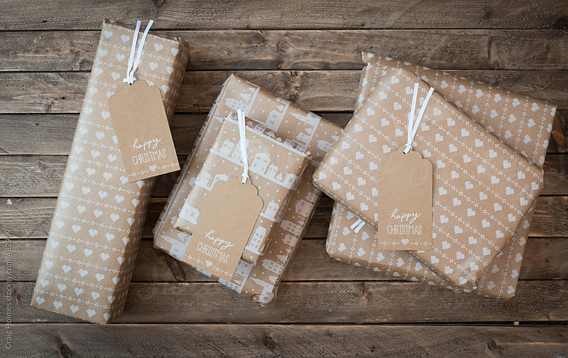 A Christmas gift on a wooden background by Craig Holmes for Stocksy United