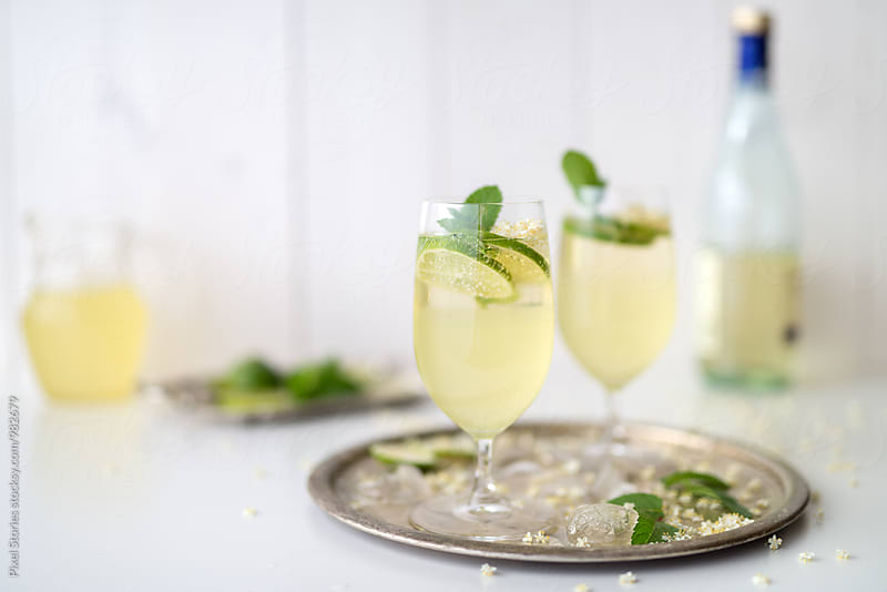 Elderflower syrup аnd Champagne Cocktail by Pixel Stories for Stocksy United