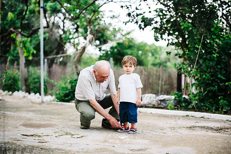 Grandfather with his grandson outdoor by Nasos Zovoilis for Stocksy United