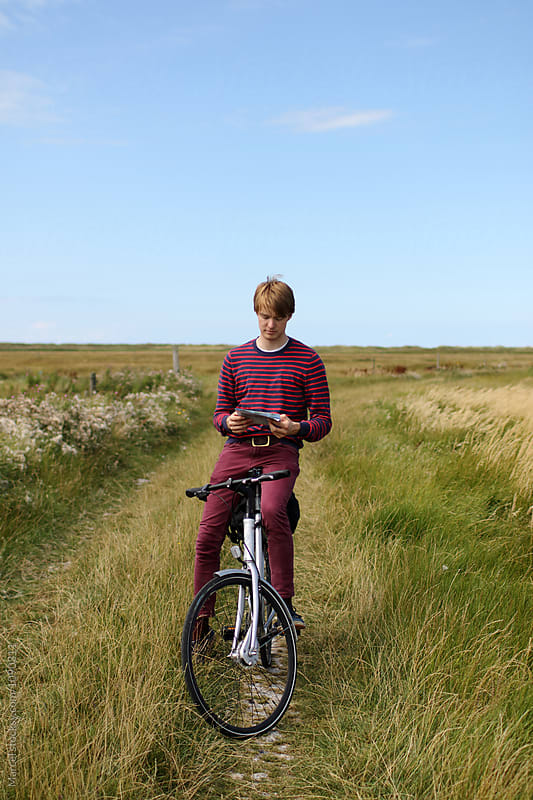Man cycling through nature by Marcel for Stocksy United