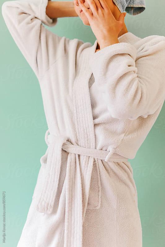 Woman in a white bathrobe by Marija Kovac for Stocksy United