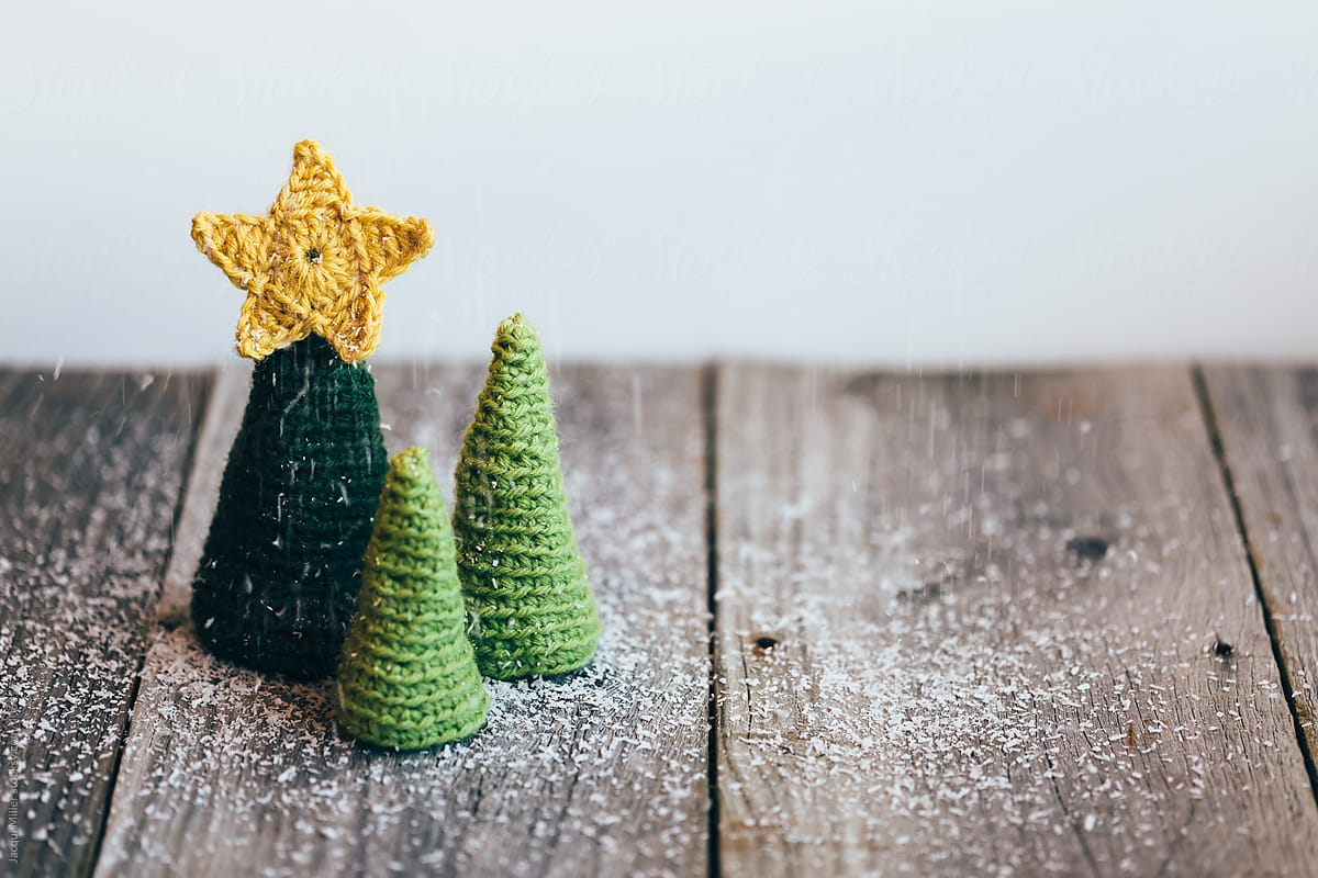 Three Little Crocheted Christmas Trees With Artificial Snow On A Rustic Wooden Table By Jacqui Miller Christmas Xmas Stocksy United