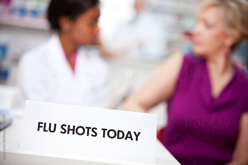 Pharmacy: Store offering Flu Shots by Sean Locke for Stocksy United