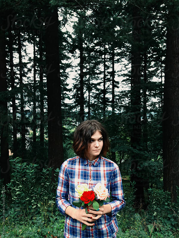 Girl in forest with roses by Kevin Gilgan for Stocksy United