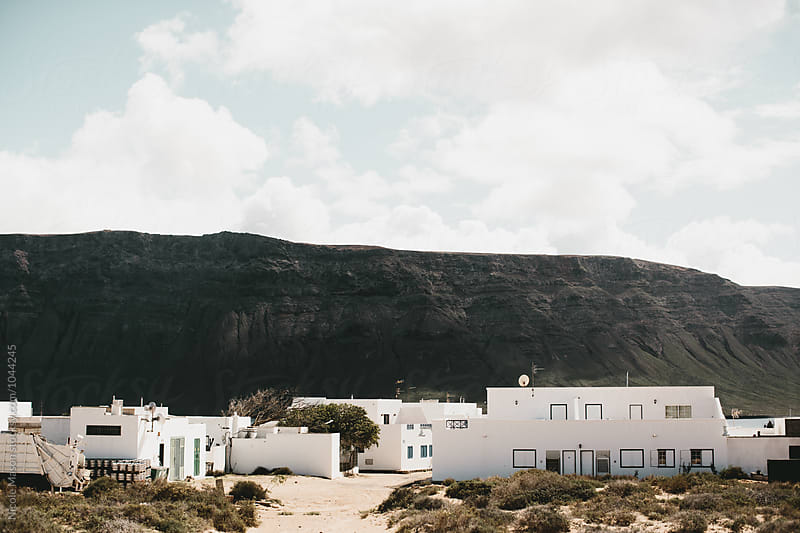 buildings on volcanic island landscape in spain by Nicole Mason for Stocksy United