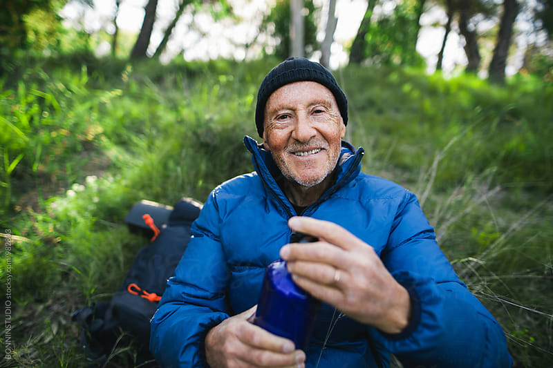 Portrait of a senior mountaineer resting in the nature.  by BONNINSTUDIO for Stocksy United