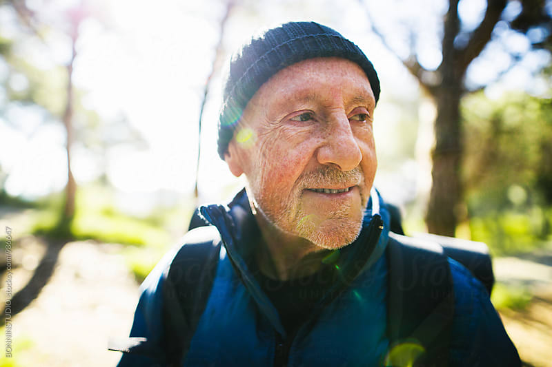 Portrait of a hiker senior man in the woods.  by BONNINSTUDIO for Stocksy United