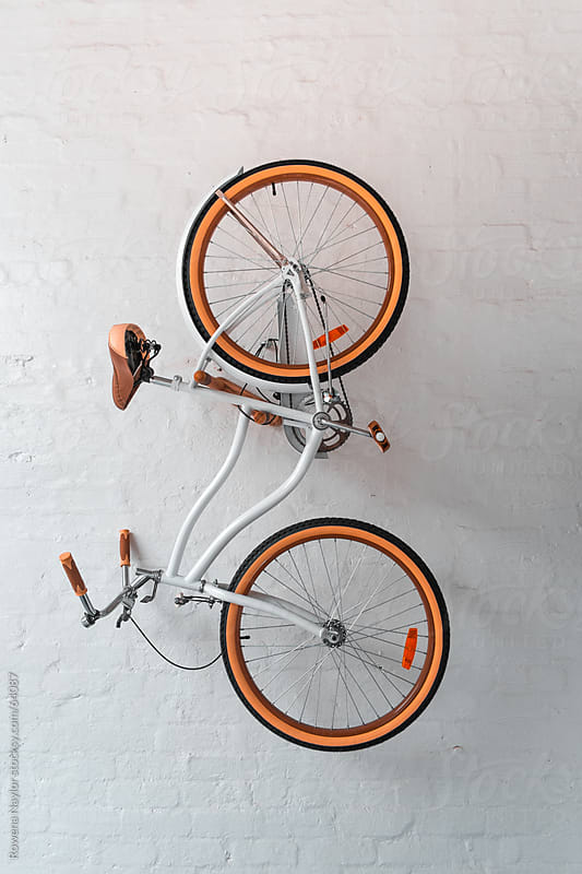 How To Hang Bike On Wall retro style bike hanging on white wallrowena naylor - stocksy