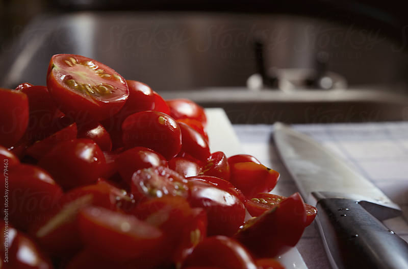 cherry tomatoes ready for roasting by Samantha Wesselhoft for Stocksy United