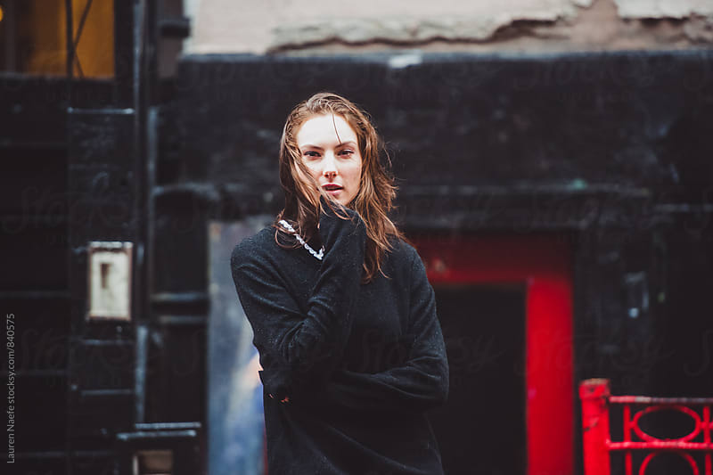 Standing outside in the rain by Lauren Naefe for Stocksy United