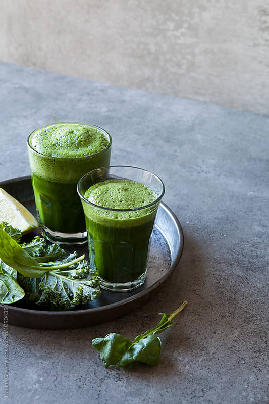 Freshly juiced kale and spinach drinks by Nadine Greeff for Stocksy United