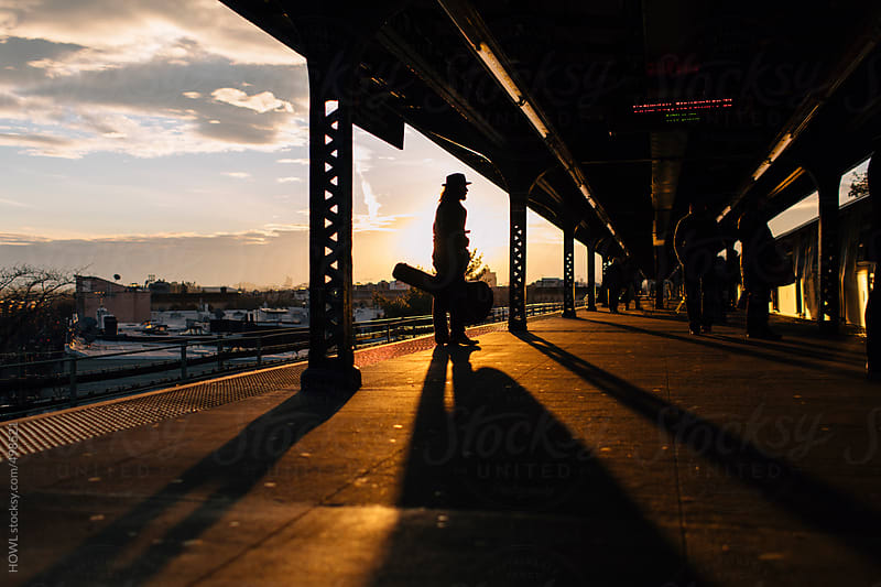 Man waiting on the subway platform  by HOWL for Stocksy United