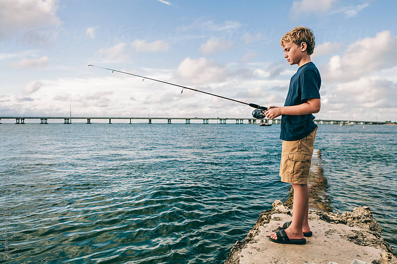 Boy Fishing in the Florida Keys by Stephen Morris for Stocksy United
