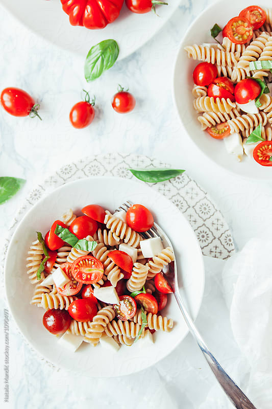 Delicious pasta caprese by Nataša Mandić for Stocksy United