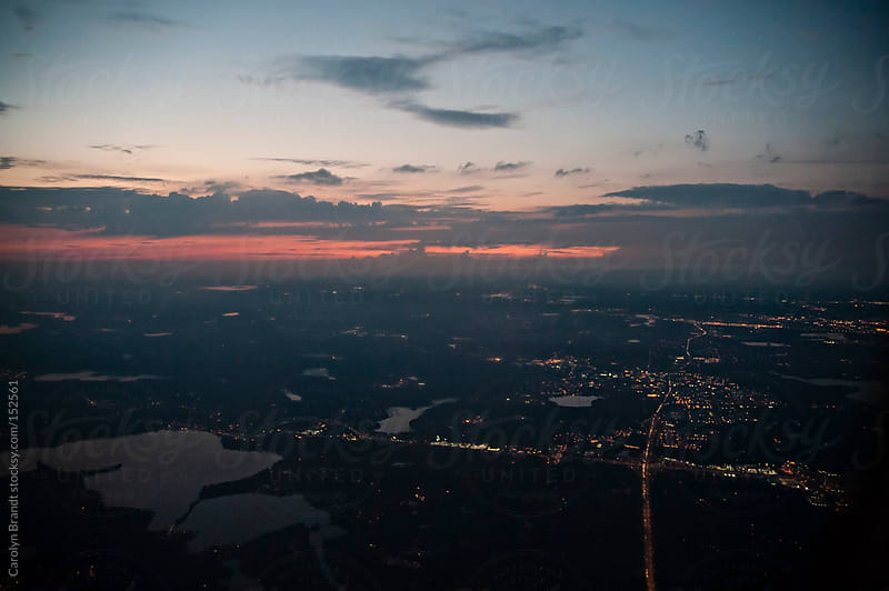 sunset aerial view of Minneapolis, Minnesota by Carolyn Brandt for Stocksy United