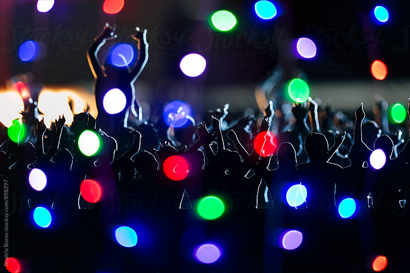Bokeh lights all over at a concert by Beatrix Boros for Stocksy United