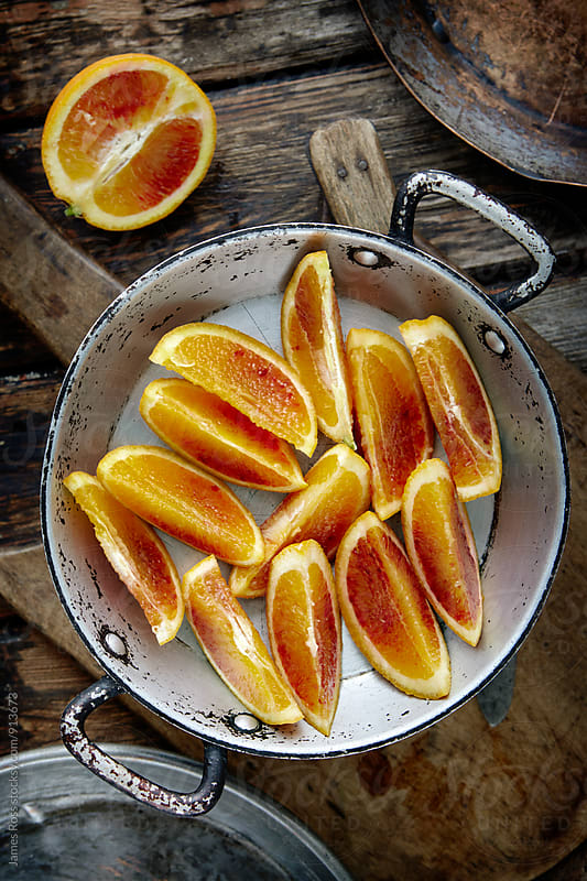 Sliced blood oranges by James Ross for Stocksy United
