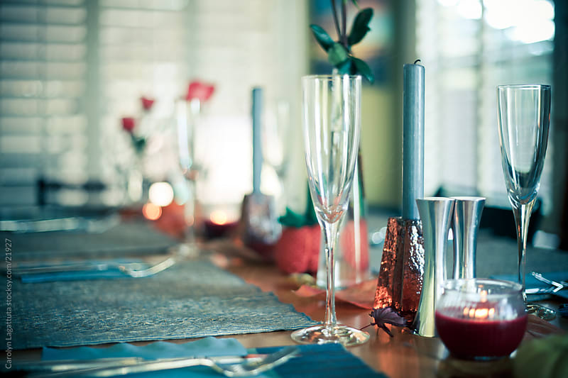 Holiday table with champange glasses by Carolyn Lagattuta for Stocksy United