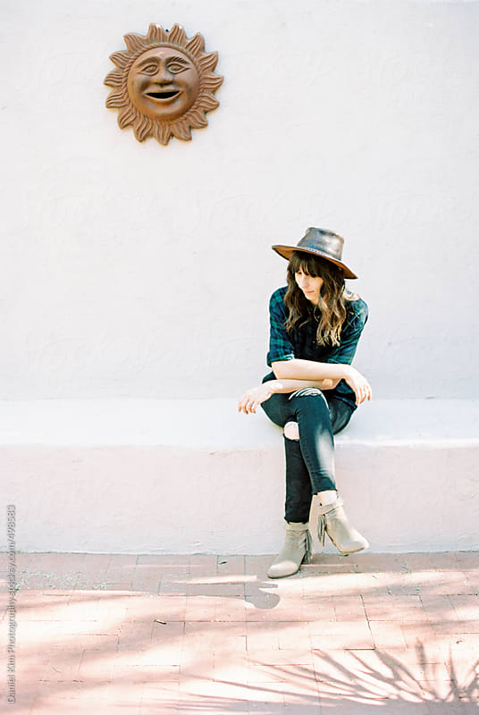 Woman sitting outdoors by Daniel Kim Photography for Stocksy United