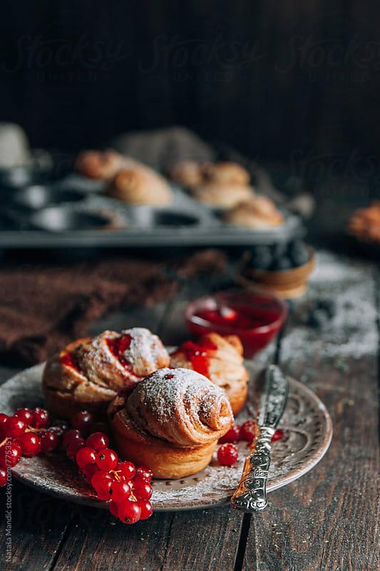 Homemade cinnamon rolls with raspberries glaze by Nataša Mandić for Stocksy United
