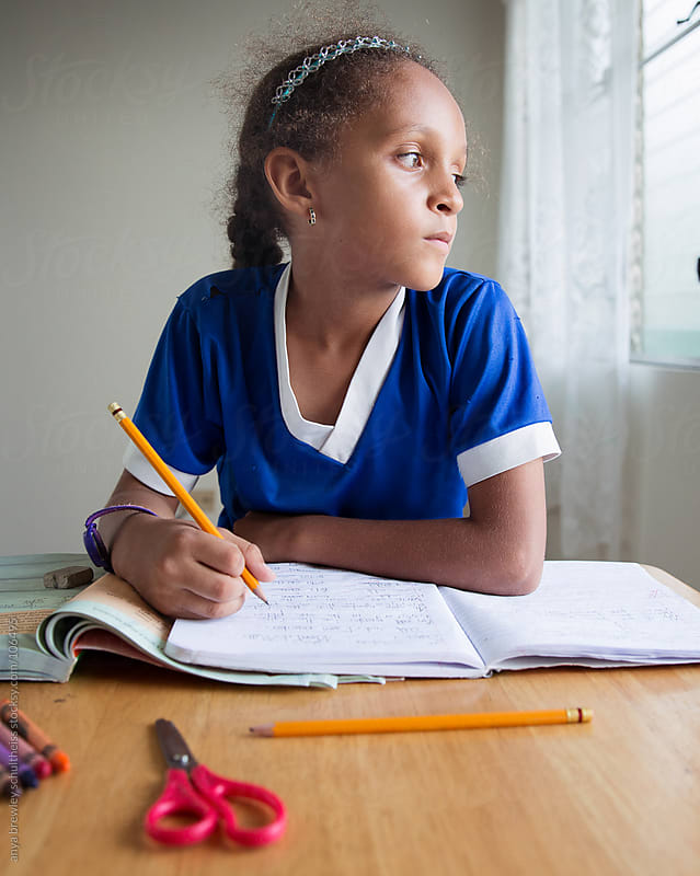 Young girl doing homework by anya brewley schultheiss for Stocksy United
