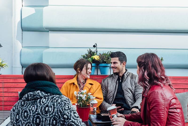 Friends having a talk in the cafe by Boris Jovanovic for Stocksy United