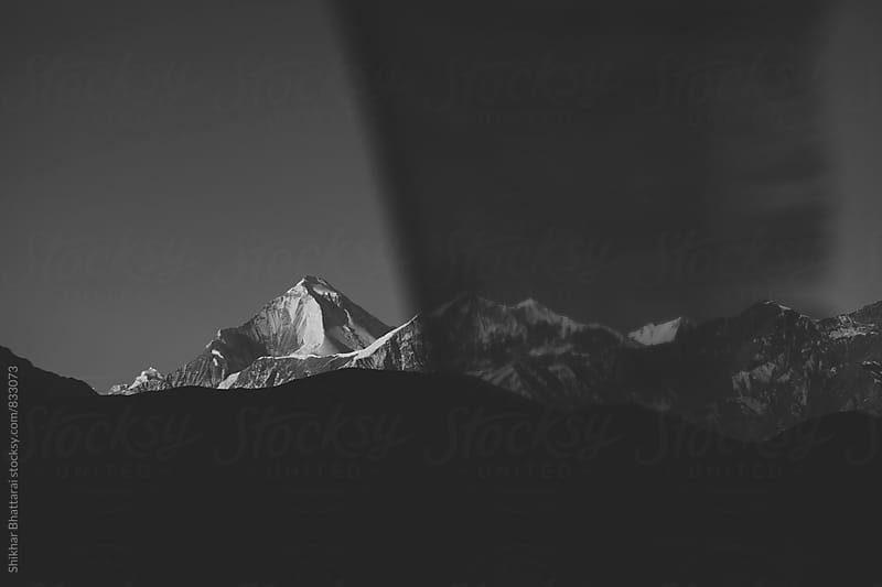 Black and white shot of Mt. Dhaulagiri in early sunrise. by Shikhar Bhattarai for Stocksy United