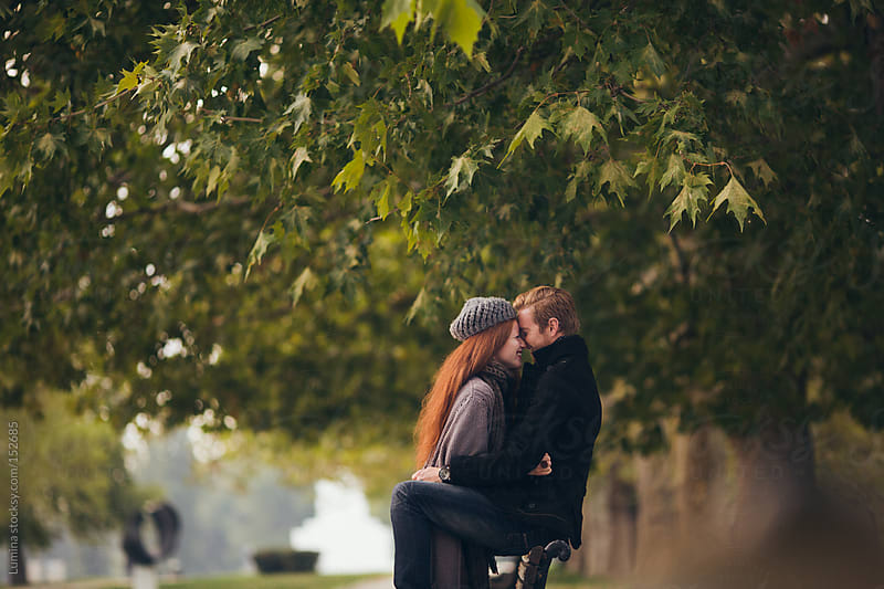 Red-Haired Couple Kissing by Lumina for Stocksy United