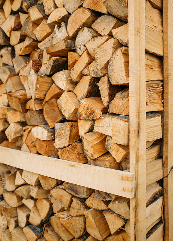 Firewood prepared for winter by Marko Milovanović for Stocksy United