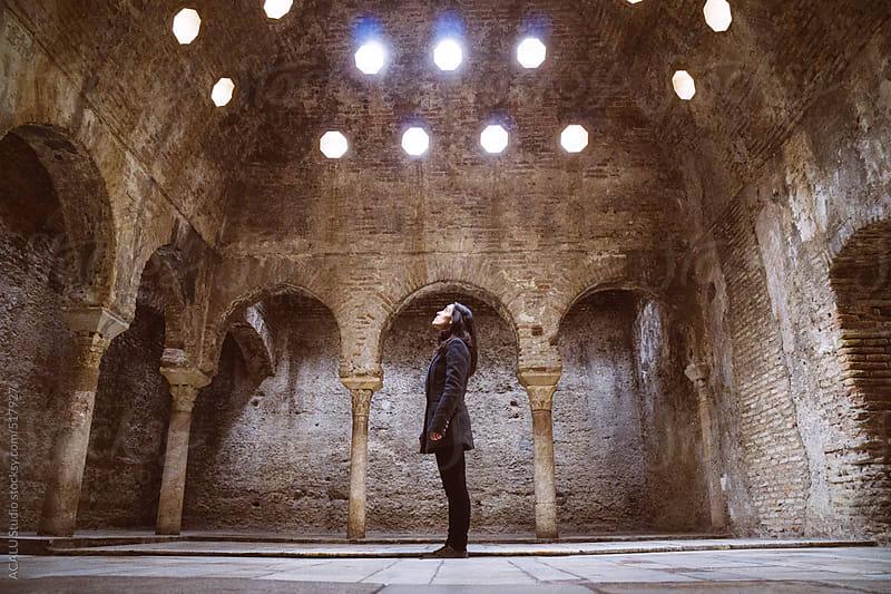 Woman inside abandoned Arab baths by ACALU Studio for Stocksy United