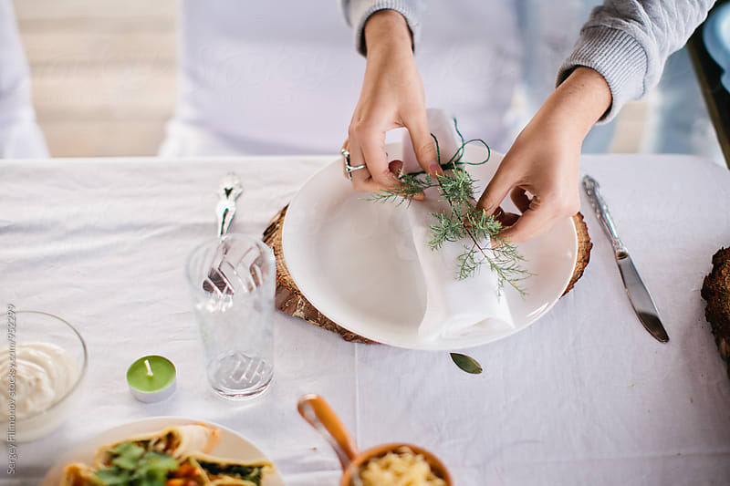 Woman prepare table decoration for dinner party by Sergey Filimonov for Stocksy United