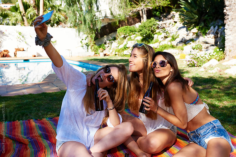 Three girlfriends taking selfie on backyard by Guille Faingold for Stocksy United