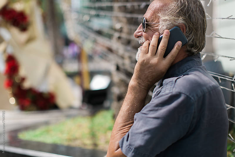 Older Man Talking on the Phone by Mosuno for Stocksy United