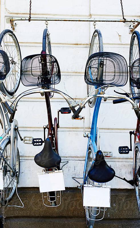 bikes hanging on white outside wall by Atakan-Erkut Uzun for Stocksy United