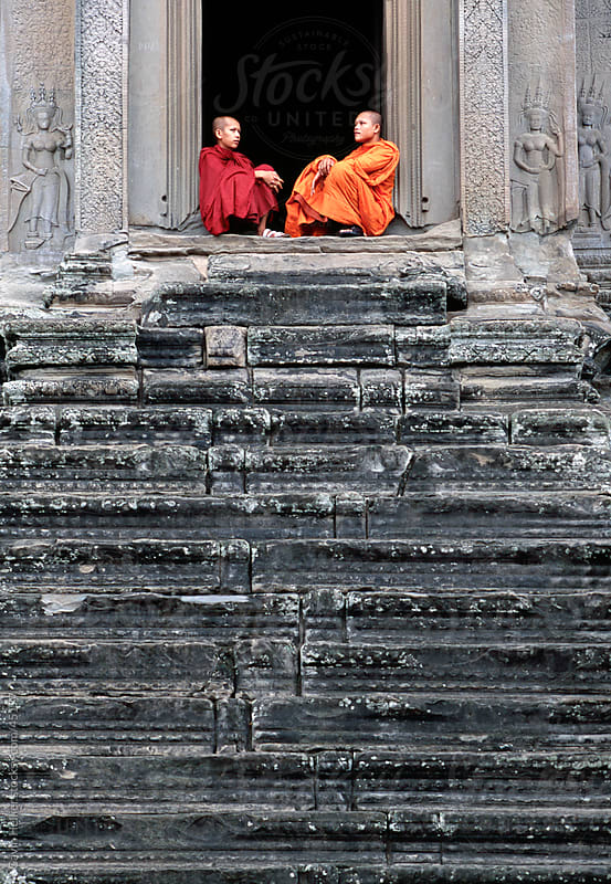 Monks on steps, Angkor Wat, Siem Reap, Cambodia, Indochina, Asia by Gavin Hellier for Stocksy United